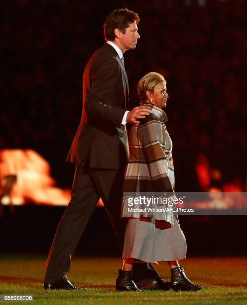 Gillon McLachlan Chief Executive Officer of the AFL and Aunty Pam Pedersen look on during the 2017 AFL round 10 Dreamtime at the G match between the...