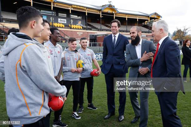 Gillon McLachlan Chief Executive Officer of the AFL Bachar Houli of the Tigers and Malcolm Turnbull Prime Minister of Australia speak during the...