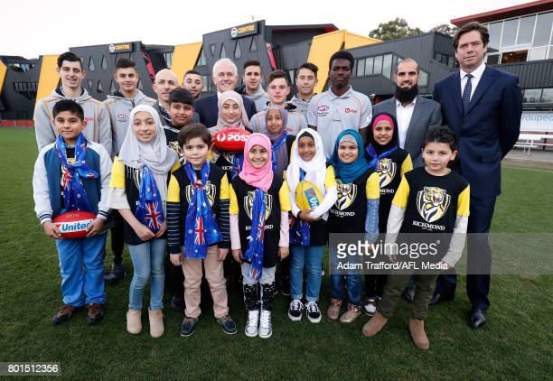 Gillon McLachlan Chief Executive Officer of the AFL Bachar Houli of the Tigers and Malcolm Turnbull Prime Minister of Australia pose for a photo with...
