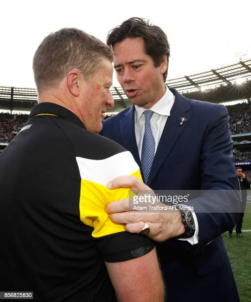 Gillon McLachlan Chief Executive Officer of the AFL congratulates Damien Hardwick Senior Coach of the Tigers during the 2017 Toyota AFL Grand Final...