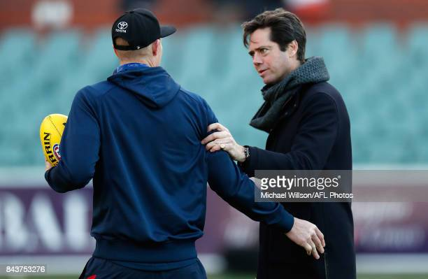 Gillon McLachlan Chief Executive Officer of the AFL passes on his condolences to Sam Jacobs of the Crows during the AFL First Qualifying Final match...