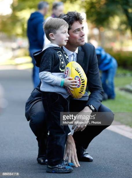 Gillon McLachlan Chief Executive Officer of the AFL poses for a photograph with a fan during the 2017 Toyota AFL Sir Doug Nicholls Indigenous Round...
