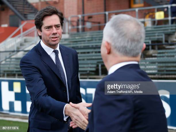 Gillon McLachlan Chief Executive Officer of the AFL shakes hands with Malcolm Turnbull Prime Minister of Australia arrive during the Bachar Houli...