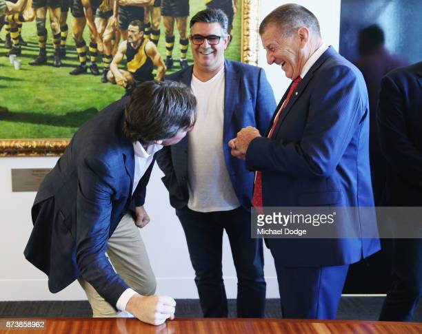 Gillon McLachlan former AFL CEO Andrew Demetriou and incoming Hawks President Jeff Kennett share a joke together during the book launch for 'Patrick...