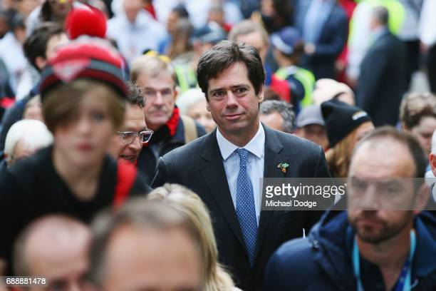 Gillon McLachlan joins in for The Long Walk during the round 10 AFL match between the Richmond Tigers and the Essendon Bombers at Melbourne Cricket...