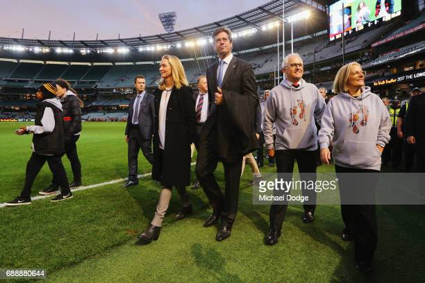 Gillon McLachlan joins Prime Minister Malcom Turnbull and his wife Lucy Turnbull for The Long Walk during the round 10 AFL match between the Richmond...
