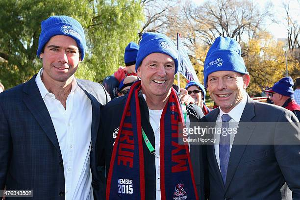 Gillon McLachlan Neale Daniher and prime minister Tony Abbott pose for a photo as they walk to the MCG ahead of the round 10 AFL match between the...