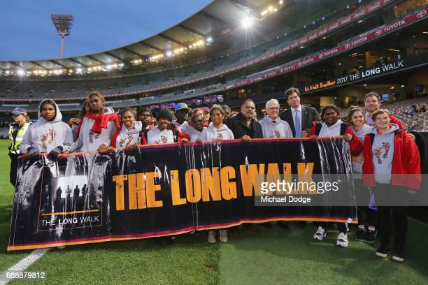 Gillon McLachlan Opposition Leader Bill Shorten Prime Minister Malcom Turnbull and his wife Lucy Turnbull join former Bombers legend Michael Long for...