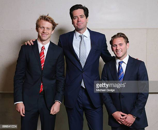 Gillon McLachlan poses with Callum Mills of the Swans and Caleb Daniel of the Bulldogs during the 2016 AFL Rising Star Announcement at Crown...