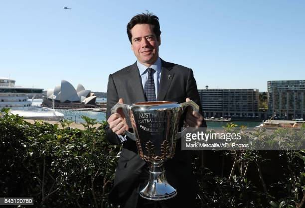 Gillon McLachlan poses with the AFL trophy during the AFL Grand Final media announcement at The Museum of Contemporary Art Australia on September 6...