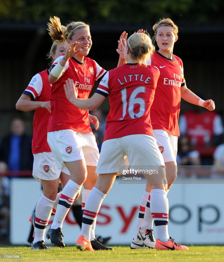 Gilly Flaherty (2nd L) of Arsenal celebrates with team-mates Kim Little and <a gi-track='captionPersonalityLinkClicked' href=/galleries/search?phrase=Ellen+White&family=editorial&specificpeople=4436830 ng-click='$event.stopPropagation()'>Ellen White</a> after scoring a goal for their team during the FA Women's Super League match between Arsenal Ladies FC and Chelsea Ladies FC at Meadow Park on June 6, 2013 in Borehamwood, England.