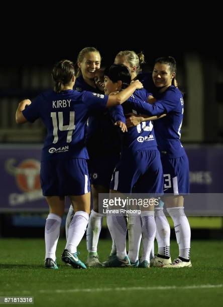 Gilly Flaherty of Chelsea celebrates with team mates after scoring her sides third goal during the UEFA Women's Champions League match between...