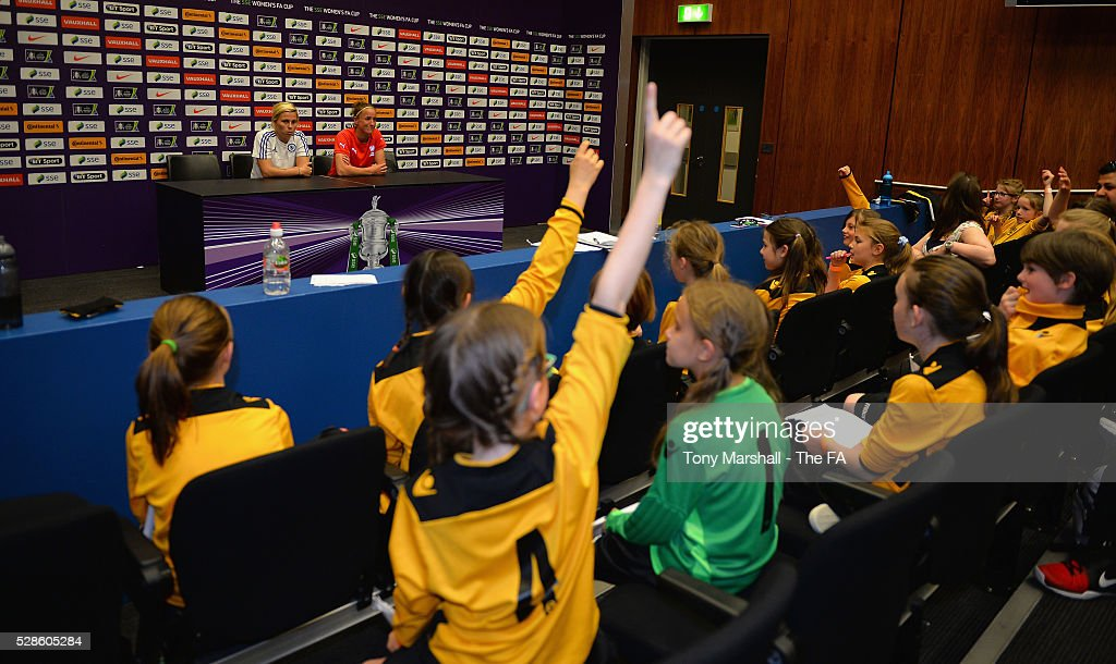 Gilly Flaherty of Chelsea FC Ladies and Casey Stoney of Arsenal Ladies are interviewed by players of Stockfold Juniors FC during the SSE Women's FA Cup Final - Wembley Media Day at Wembley Stadium on May 6, 2016 in London, England.