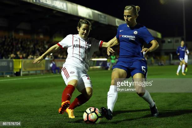 Gilly Flaherty of Chlesea Ladies is tackled by Nicole Rosler of Bayern Munich during the UEFA Womens Champions League Round of 32 First Leg match...