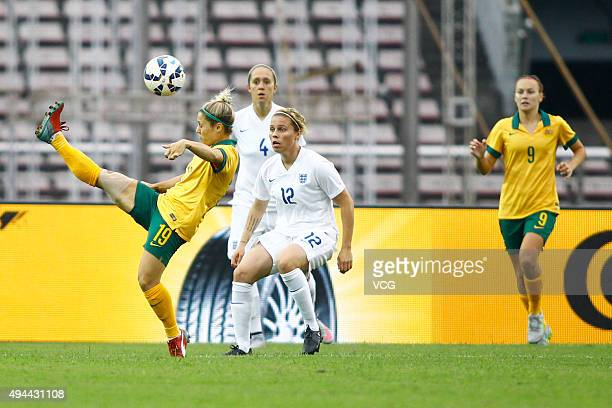 Gilly Flaherty of England and Katrina Gorry of Australia compete for the ball in the match between England and Australia during the 2015 Yongchuan...