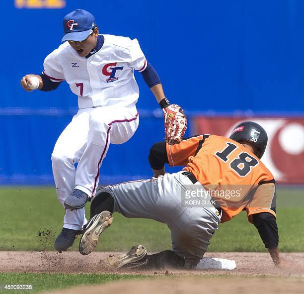 Gilmer Lampe of The Netherlands is out on second base in the group match between The Netherlands and Taiwan during the baseball Haarlem Honkbal Week...