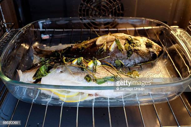 Gilthead sea bream being cooked in the oven
