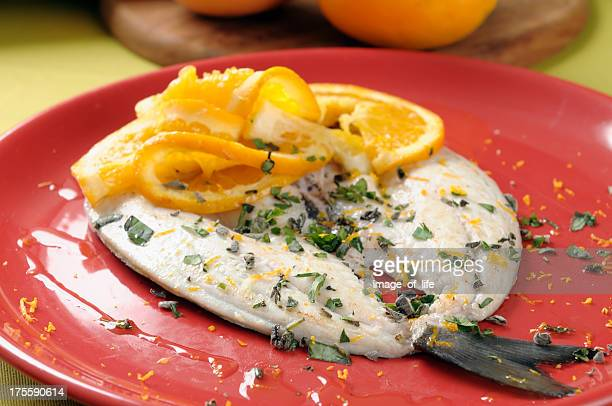 Gilthead bream stock photos and pictures getty images for Aromatic herb for fish