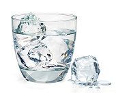 Gin, vodka or icy water in rocks glass isolated on white background
