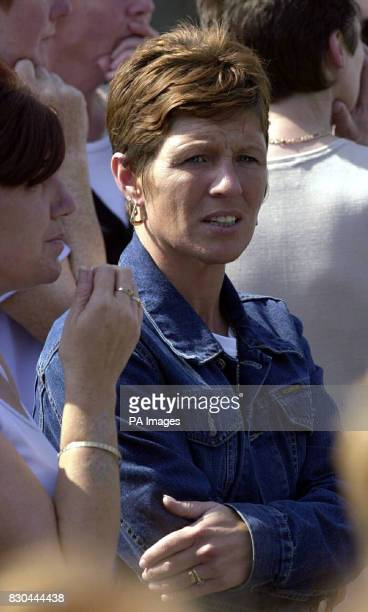Gina Adair wife of loyalist prisoner Johnny Adair during the funeral service of Jackie Coulter outside his home in St Mary's Court Belfast Coulter...