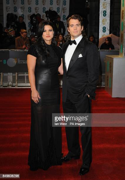 Gina Carano and Henry Cavill arriving for the 2013 British Academy Film Awards at the Royal Opera House Bow Street London