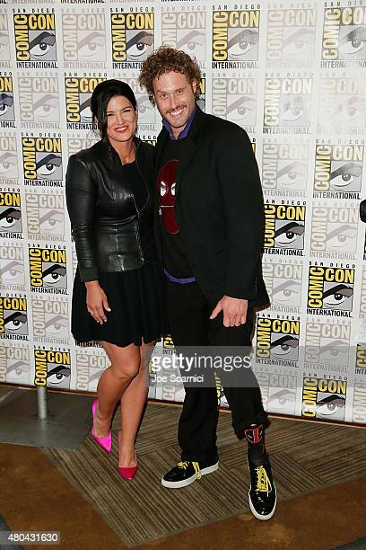 Gina Carano and TJ Miller attend the 20'th Century Fox Press Line at ComicCon International 2015 Day 3 on July 11 2015 in San Diego California