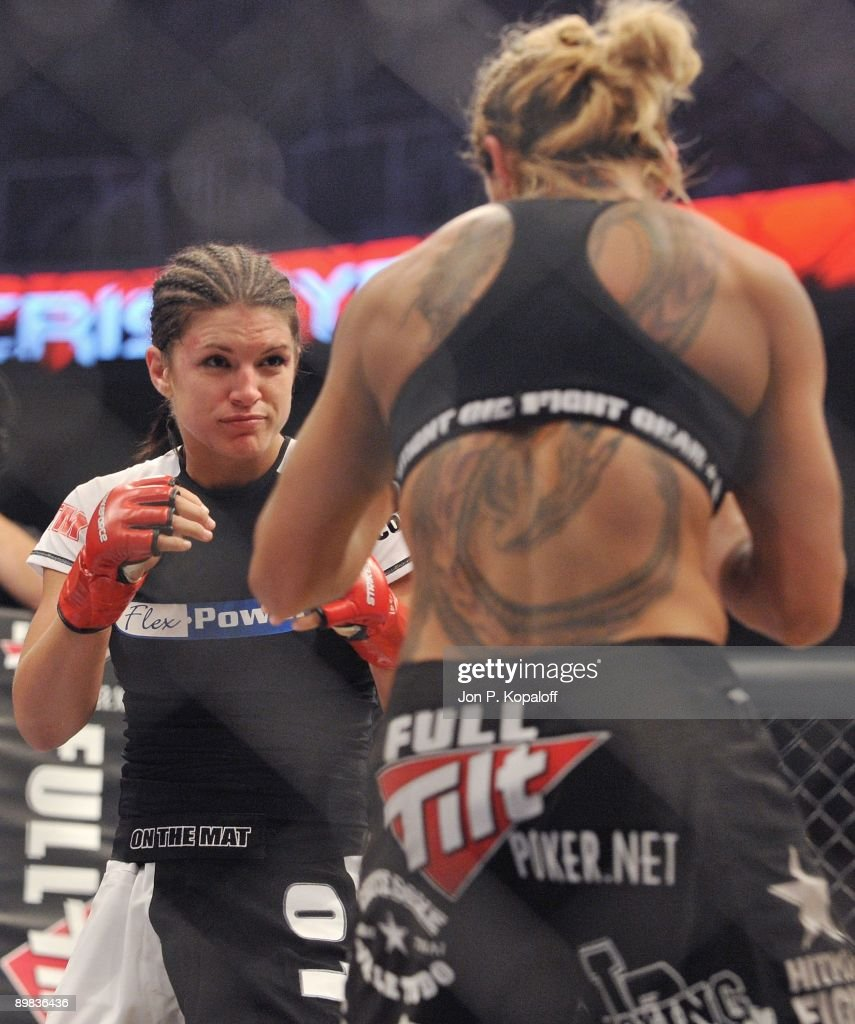 Gina Carano (L) battles Cris Cyborg during their Middleweight Championship fight at Strikeforce: Carano vs. Cyborg on August 15, 2009 in San Jose, California.