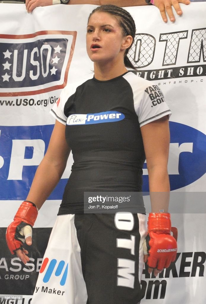 Gina Carano (Pictured) waits for the start of the first round against Cris Cyborg during their Middleweight Championship fight at Strikeforce: Carano vs. Cyborg on August 15, 2009 in San Jose, California.