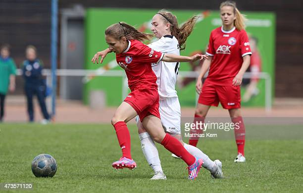 Gina Chemielinski of Potsdam battles for the ball with Sophia Kleinherne of Guetersloh during the U17 Girl's Bundesliga semi final first leg match...
