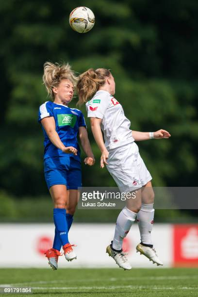 Gina Chmielinski of Potsdam and AnnKathrin Vinken of Koeln head the ball during the B Junior Girl's German Championship Semi Final match between 1 FC...
