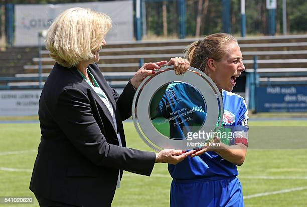 Gina Chmielinski of Potsdam get's the trophy after winning the U17 Girl's German Championship final match between 1FFC Turbine Potsdam and FSV...