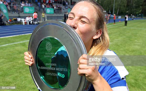 Gina Chmielinski of Potsdam kisses the trophy after winning the U17 Girl's German Championship final match between 1FFC Turbine Potsdam and FSV...