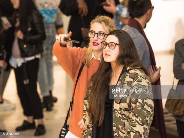 Gina Clarke and Sam Tasman during the opening of the Andy Warhol exhibition at the Wits Art Museum on July 26 2017 in Johannesburg South Africa The...