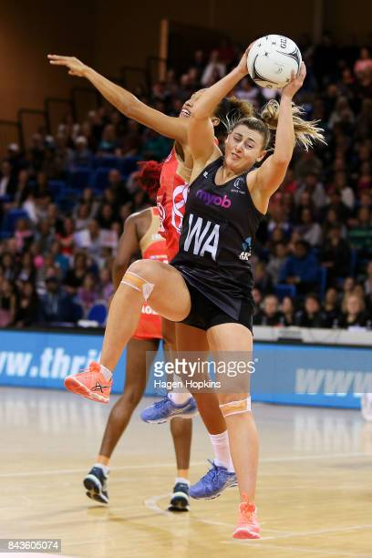 Gina Crampton of New Zealand secures a pass under pressure from Serena Guthrie of England during the International test match between the New Zealand...