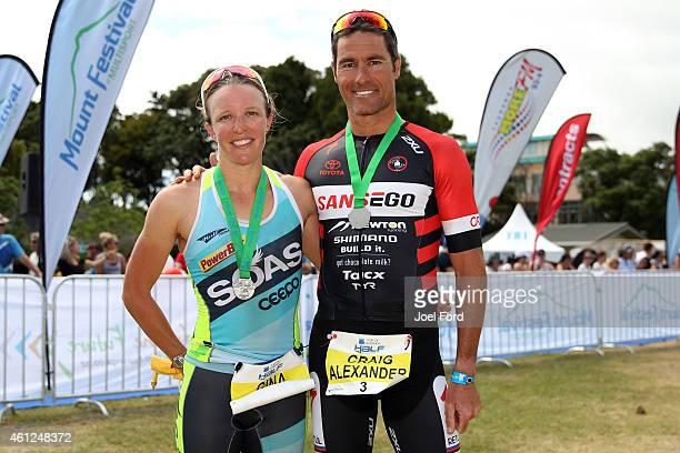 Gina Crawford and Craig Alexander winners of the 2015 Port of Tauranga Half Ironman on January 10 2015 in Tauranga New Zealand