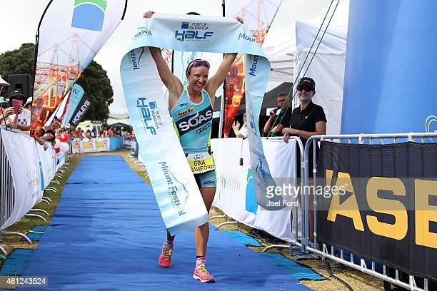 Gina Crawford crosses the finish line to win the Port of Tauranga Half Ironman on January 10 2015 in Tauranga New Zealand