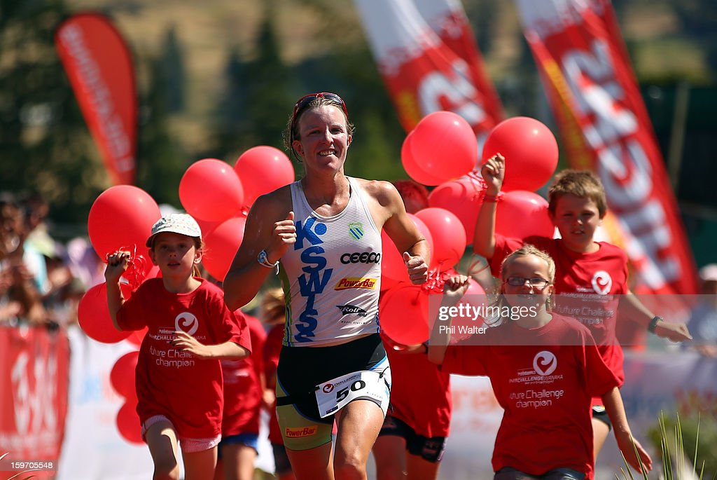 Gina Crawford of New Zealand crosses the finish line to be the first female home in the Challenge Wanaka on January 19, 2013 in Wanaka, New Zealand.