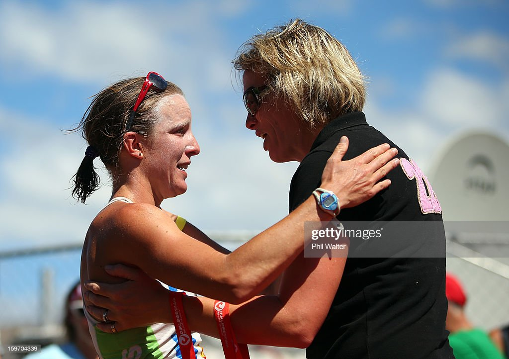 Gina Crawford of New Zealand (L) is congratulated by race director Victoria Murray-Orr (R) after crossing the finish line to be the first female home in the Challenge Wanaka on January 19, 2013 in Wanaka, New Zealand.