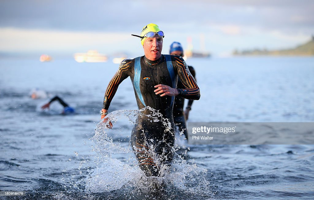Gina Crawford of New Zealand leaves the water after the swim leg during the New Zealand Ironman on March 2, 2013 in Taupo, New Zealand.