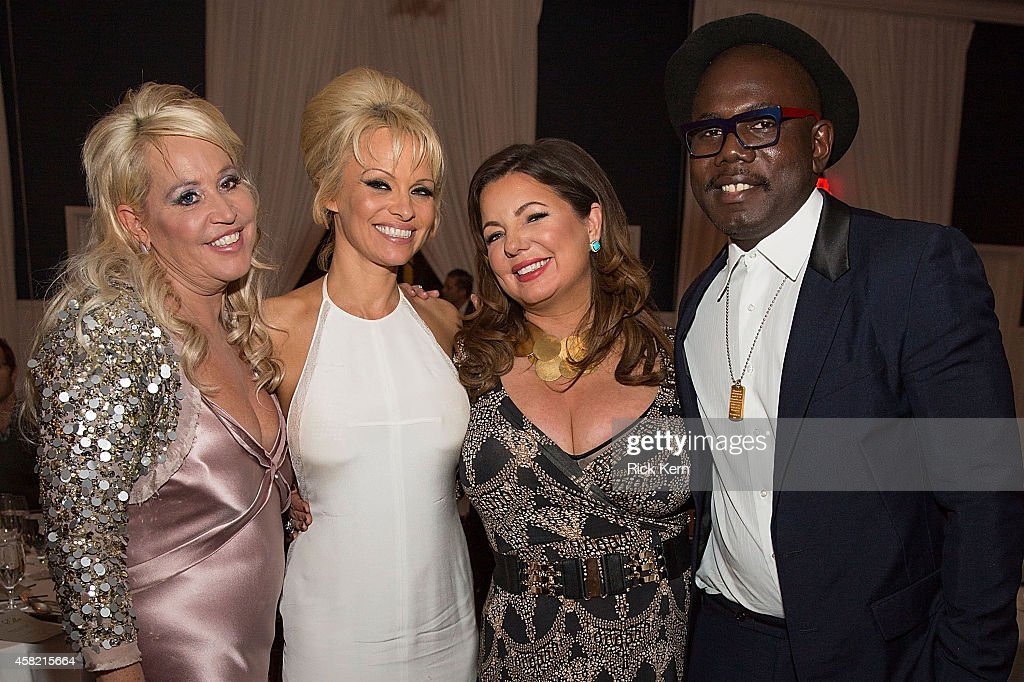 Gina de Franco executive producer and creator of the Better World Awards, actress Pamela Anderson, Olivia Gaynor Long, and Kweku Mandela attend the 5th Annual Better World Awards at Hotel Ella on October 31, 2014 in Austin, Texas.