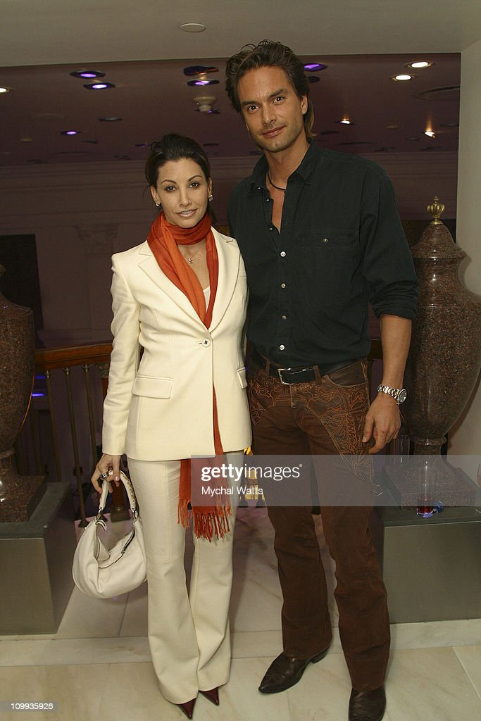 Gina Gershon and Marcus Schenkenberg during Absolut Out Benefit for the Human Rights Campaign Foundation at Versache Store 5th ave in New York City...