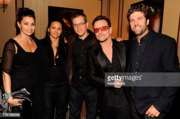 Gina Gershon Luciana Barroso Matt Damon and Bono of U2 backstage at 'SpiderMan Turn Off The Dark' Broadway opening night at Foxwoods Theatre on June...