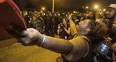 Gina KeyConrad pleads with Baton Rouge police in riot gear as they move in on the protesters over the Alton Sterling shooting on July 9 2016 in Baton...