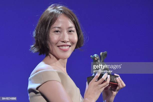 Gina Kim poses with the Best VR award for her movie 'Bloodless' during the award ceremony of the 74th Venice Film Festival on September 9 2017 at...