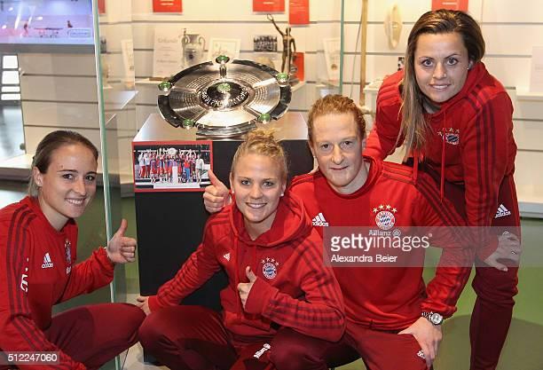 Gina Lewandowski Leonie Maier Melanie Behringer and Nora Holstad of FC Bayern Muenchen handover the 2015 Women's German Champioship trophy to the FCB...