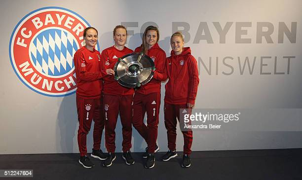 Gina Lewandowski Melanie Behringer Nora Holstad and Leonie Maier of FC Bayern Muenchen pose with the 2015 Women's German Champioship trophy before...