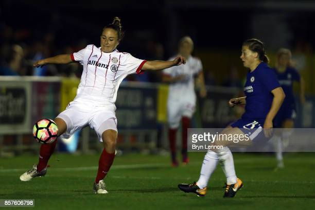 Gina Lewandowski of Bayern Munich avoids Fran Kirby of Chelsea Ladies during the UEFA Womens Champions League Round of 32 First Leg match between...