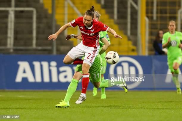 Gina Lewandowski of Munich and Alexandra Popp of Wolfsburg battle for the ball during the Women's DFB Cup Quarter Final match between FC Bayern...
