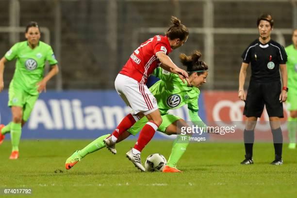 Gina Lewandowski of Munich and Vanessa Bernauer of Wolfsburg battle for the ball during the Women's DFB Cup Quarter Final match between FC Bayern...