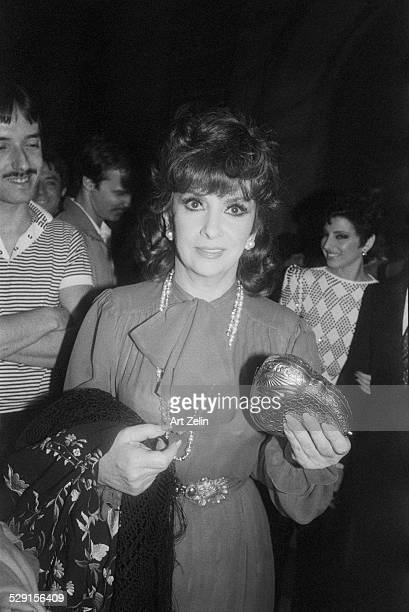 Gina Lollobrigida carrying an evening purse leaving a formal event circa 1970 New York